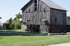 Amish buggy and old barn in the country Stock Photos