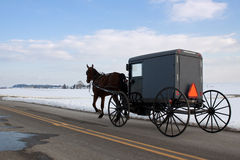 Amish Carriage. An Amish carriage travels in snow covered Lancaster County,Pennsylvania,USA Stock Photography
