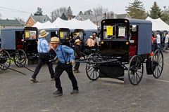 Amish Carriage Auction in Lancaster County. GAP PENNSYLVANIA - MARCH 25, 2017: An Amish man moves a new carriage which is for sale at the annual `Amish Mud Sale Royalty Free Stock Photos