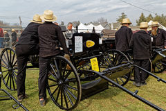 Amish Carriage Auction in Lancaster County. GAP PENNSYLVANIA - MARCH 25, 2017: Amish men looking at new and used carriages at the annual `Amish Mud Sale` which Royalty Free Stock Photography