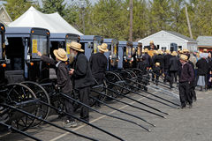 Amish Carriage Auction in Lancaster County. GAP PENNSYLVANIA - MARCH 25, 2017: Amish men looking at new and used carriages at the annual `Amish Mud Sale` which Stock Photos