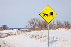 Amish carriage on the road sign Royalty Free Stock Photos