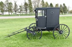 Amish Carriage. This is a Spring picture of an Amish Carriage unhitched in Next to an Amish Store located in St. Charles, Minnesota in Winona County.  This Stock Image