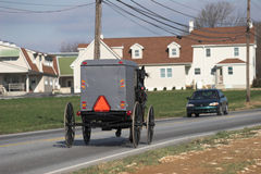 Amish cart. And car passing each other in pennsylvania dutch country Stock Images