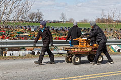 Amish Delivery Boys. GORDONVILLE PENNSYLVANIA - March 11, 2017: Amish boys deliver items for buyers at the annual spring auction `Amish Mud Sale` to benefit the Stock Images