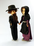 Amish dolls. An Amish couple, man and women dolls dressed in traditional black clothes royalty free stock photos