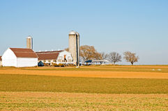 Amish farm barns and silo. A view of a classic Amish farm and barns in the rural countryside near Lancaster, Pennsylvania, (USA Stock Photography