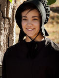 Amish Girl. On the bench Royalty Free Stock Images