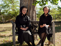 Amish Girls. Two amish girls on the bench Royalty Free Stock Photography