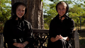 Amish Girls. Two amish girls on the bench Royalty Free Stock Photos