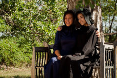 Amish Girls. Two amish girls on the bench Stock Image