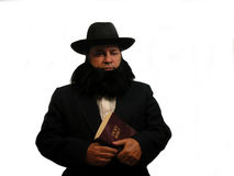 Amish Man. An Amish man holding a bible, over white Royalty Free Stock Photography