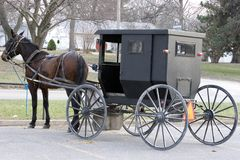 Amish Parking Space. An amish buggy and horse at a local grocery stores amish hitching post stock photos