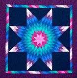 Amish quilt. Beautiful Amish quilt. square pattern with starburst royalty free stock images