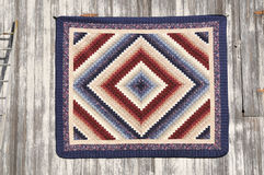 Amish quilt. Handmade Amish quilt hanging on a barn wall stock image
