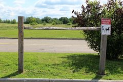 Amish. Reserved parking post and signage for Amish to park their horse and buggy at a local rural store in rural Constable, New York Stock Images