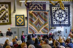 Amish Selling Quilts. Bart, PA, USA - March 3, 2018: Quilts are just one the many items being sold at the annual Mud Sale at the Bart Fire Company Stock Photography