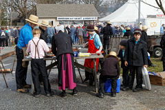 Amish Volunteers Packaging Barbecued Chicken Stock Images