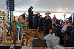 Amish Volunteers Sell Furniture and Crafts Royalty Free Stock Image