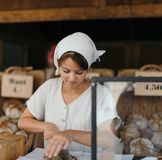 Amish woman working in bakery