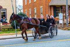 Amish Women Riding in Tall Wagon in Intercourse Royalty Free Stock Images