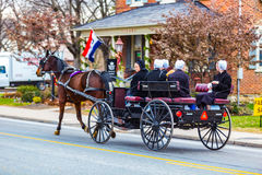 Amish Women Riding in Wagon in Intercourse Stock Photos