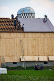 Amish Work on Barn Roof Stock Photos