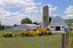 Amish Youth Painting Farm Buildings Stock Photo