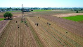 Amishlandbouwer Harvesting Crop Drone stock footage