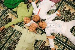 Amistad, cabritos musulmanes Fotografía de archivo