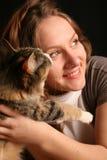 Amistad con el gato Fotos de archivo