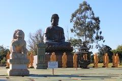 Amitabha Buddha and Imperial Guardian Lion, Chen Tien Temple - Foz do Iguaçu royalty free stock photography