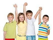 Amitié de quatre enfants Image stock