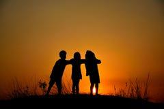 Amitié de silhouette de trois Image libre de droits
