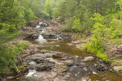Amity Creek Cascade. A small cascading waterfall on a creek in the summer Stock Photos