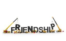 Amizade tornando-se: Máquinas que trabalham na palavra. foto de stock