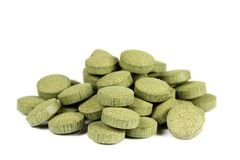 Amla C-Vitamin. A pile of nutritional supplement with spirulina (green algae) C-vitamin tablets / pills. Isolated on white background royalty free stock images