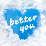 Améliorez-vous mot à l'intérieur de ciel bleu de nuage d'amour seulement Photographie stock libre de droits