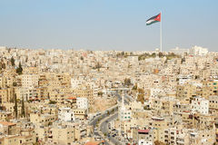 Amman city view with big Jordan flag Royalty Free Stock Image