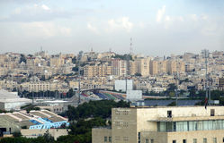 Amman la capitale de la Jordanie et les maisons et le stade Photos libres de droits