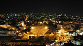Amman by night. Night city skyline and roman amphitheater in Amman and , Al-Qasr site, Jordan, Middle East Royalty Free Stock Images