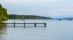 Wooden pontoons on AmmerSee lake stock images