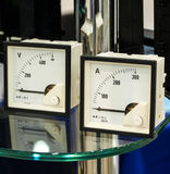 The ammeter and voltmeter. On the table with glass Royalty Free Stock Photo