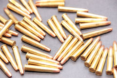 Ammo 45. Ammunition all in a cluster on a dark background Stock Photography