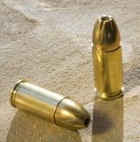 Ammo. Hollowpoint ammo in cartridges for a handgun royalty free stock photography
