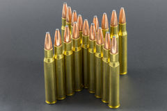 Ammo arranged in an X shape. Rifle Ammo arranged in an X shape Stock Photo