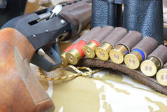 Ammo bag and gun Royalty Free Stock Images