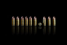 Ammo on a black background. 9 mm Stock Photography