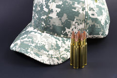 Ammo and a camo hat. Behind stock photography