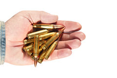 Ammo. Cartridges on a male palm.Submachine gun cartridges on a male palm isolated on a white background Royalty Free Stock Photos
